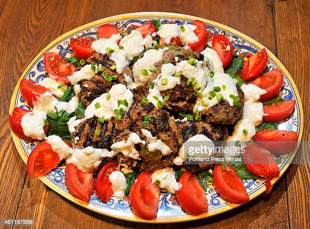 Denise Tepler made this platter filled with grilled burgers using ground lamb and ground goat meat made with fresh mint and grated onion on a bed of...