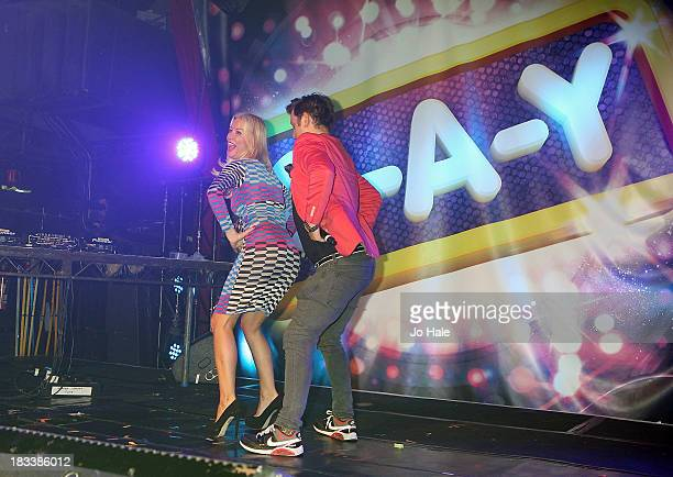 Denise Van Outen and Brian Dowling dancing on stage at the 20th Anniversary GAY Album Launch at Heaven on October 5 2013 in London England