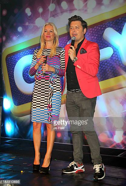 Denise Van Outen and Brian Dowling on stage at the 20th Anniversary GAY Album Launch at Heaven on October 5 2013 in London England