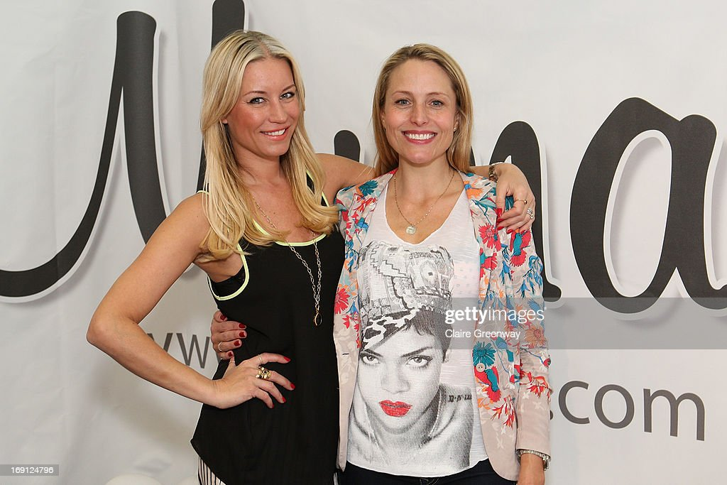 Denise van Outen (L) celebrates with 'Mumazine' editor and TV presenter Sam Mann as she joins the magazine as a celebrity contributor at Alexandra Palace on May 18, 2013 in London, England. Mumazine is an online magazine with features by and about celebrity mums and offers parenting, fashion and nutrition advice.