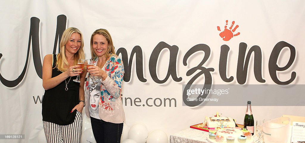 Denise van Outen (L) celebrates with 'Mumazine' editor and TV presenter Sam Mann as she joins the magazine as a celebrity contributor at Alexandra Palace on May 18, 2013 in London, England. Mumazine is an online magazine with features by and about celebrity mums and offering parenting, fashion and nutrition advice.