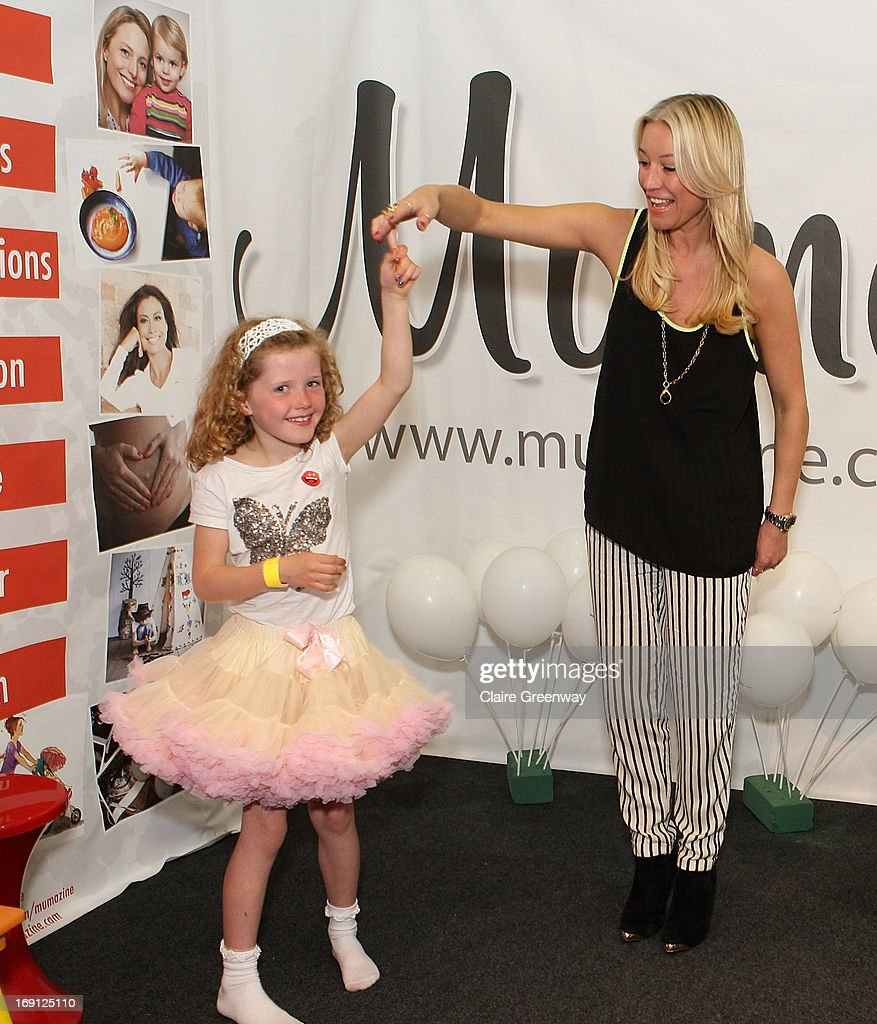 Denise van Outen gives dance tips to young fan, Nancy, as she joins 'Mumazine' magazine as a celebrity contributor at Alexandra Palace on May 18, 2013 in London, England. Mumazine is an online magazine with features by and about celebrity mums and offering parenting, fashion and nutrition advice.