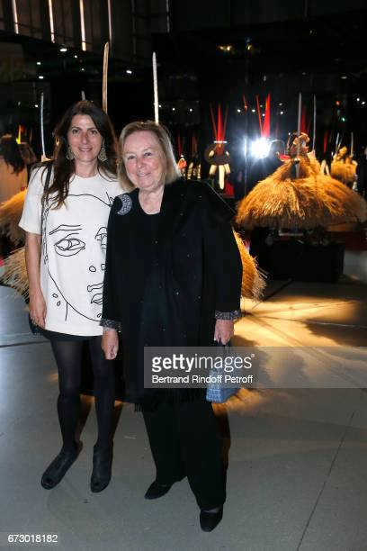 Denise Vilgrain and Maryvonne Pinault pose in front the works of JeanPaul Goude during the 'Societe des Amis du Musee d'Art Moderne du Centre...