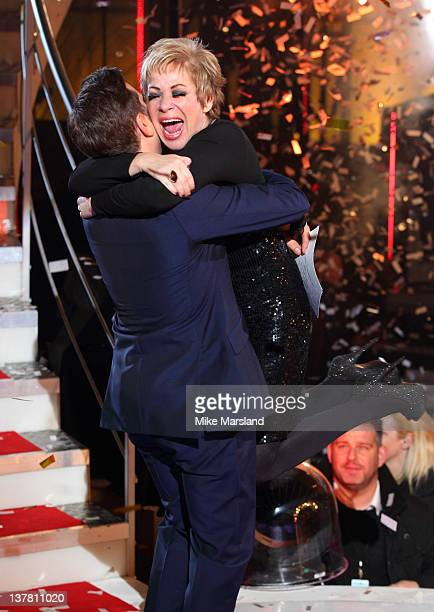 Denise Welch is embraced by host Brian Dowling as she wins Celebrity Big Brother 2012 at Elstree Studios on January 27 2012 in Borehamwood England