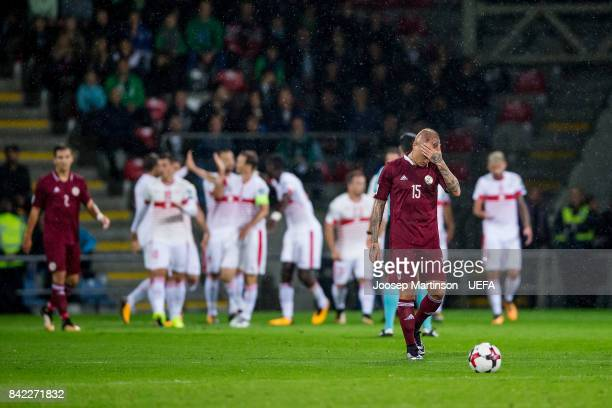 Deniss Rakels of Latvia looks dejected after Haris Seferovic of Switzerland scores during the FIFA 2018 World Cup Qualifier between Latvia and...