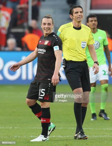 Deniz Aytekin and Julian Baumgartlinger of Leverkusen looks on during the Bundesliga match between Bayer 04 Leverkusen and VfL Wolfsburg at BayArena...
