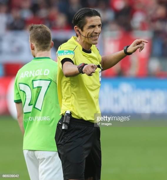 Deniz Aytekin gestures during the Bundesliga match between Bayer 04 Leverkusen and VfL Wolfsburg at BayArena on April 2 2017 in Leverkusen Germany