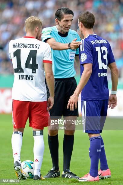 Deniz Aytekin speak with Tim Danneberg of Osnabrueck during the DFB Cup match between VfL Osnabrueck and Hamburger SV at Osnatel Arena on August 13...