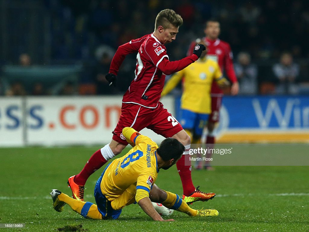 Deniz Dogan (#8) of Braunschweig and Mitchell Weiser (back) of Kaiserslautern battle for the ball during the second Bundesliga match between Eintracht Braunschweig and 1. FC Kaiserslautern at Eintracht Stadium on March 11, 2013 in Braunschweig, Germany.