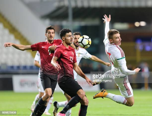 Deniz Hummet of Turkey in action against Attila Szalai of Hungary during the 2017 UEFA European Under21 Championship qualification Group 6 football...