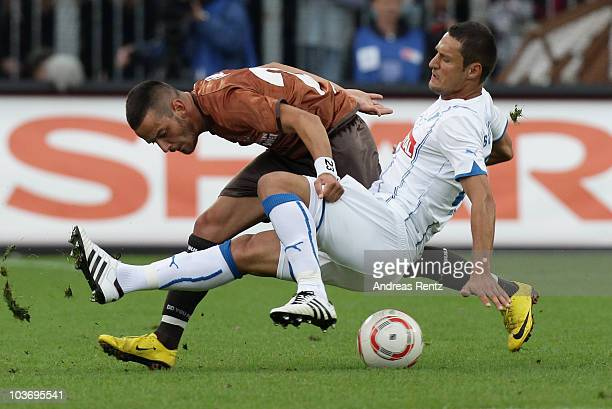 Deniz Nak of St Pauli and Sejad Salihovic of Hoffenheim battle for the ball during the Bundesliga match between FC St Pauli Hamburg and1899...