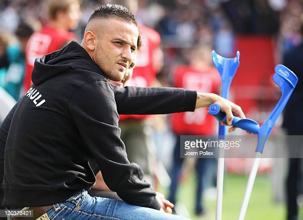 Deniz Naki of Hamburg is seen injuured prior to the Second Bundesliga match between FC St Pauli and Alemannia Aachen at Millerntor Stadium on August...