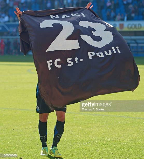 Deniz Naki of Paderborn show an oversized shirt with his namen which he received from the Sankt Pauli supporters after the Second Bundesliga match...