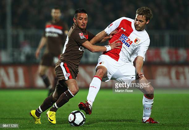 Deniz Naki of St Pauli and Daniel Brinkmann of Augsburg battle for the ball during the Second Bundesliga match between FC St Pauli and FC Augsburg at...