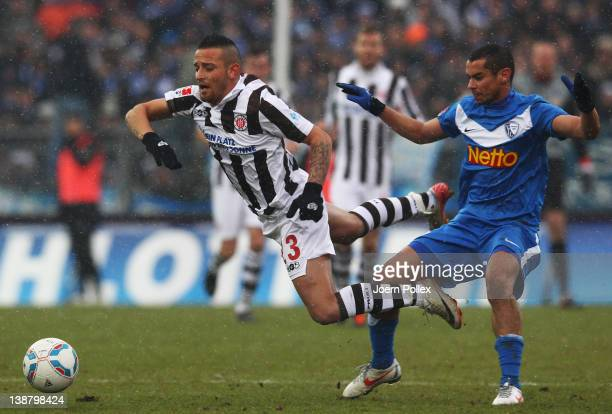 Deniz Naki of St Pauli and Mimoun Azaouagh of Bochum battle for the ball during the Second Bundesliga match between FC St Pauli and VfL Bochum at the...
