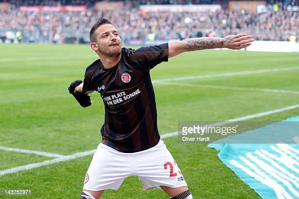 Deniz Naki of St Pauli celebrate with the supporters after the 2 Bundesliga match between StPauli and Hansa Rostock at Millerntor Stadium on April 22...
