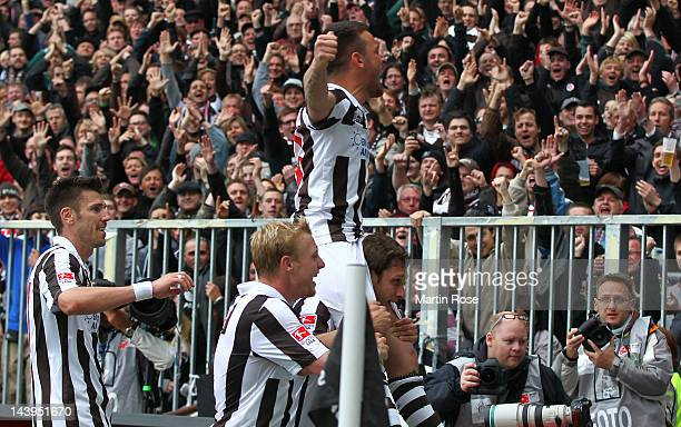 Deniz Naki of St Pauli celebrates after he scores his team's 5th goal during the Second Bundesliga match between St Pauli and SC Paderborn at the...