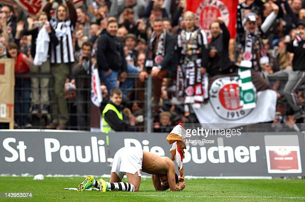 Deniz Naki of St Pauli celebrates after the Second Bundesliga match between St Pauli and SC Paderborn at the Millerntor stadium on May 6 2012 in...
