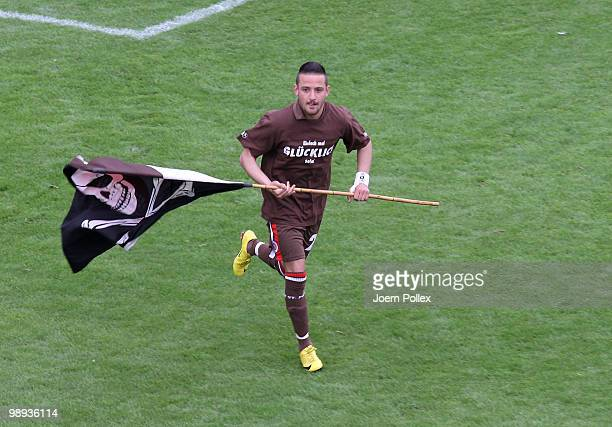 Deniz Naki of St Pauli celebrates after the Second Bundesliga match between FC St Pauli and SC Paderborn at Millerntor stadium on May 9 2010 in...