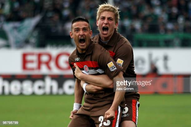 Deniz Naki of St Pauli celebrates his team's first goal with team mate Bastian Oczipka during the Second Bundesliga match between SpVgg Greuther...