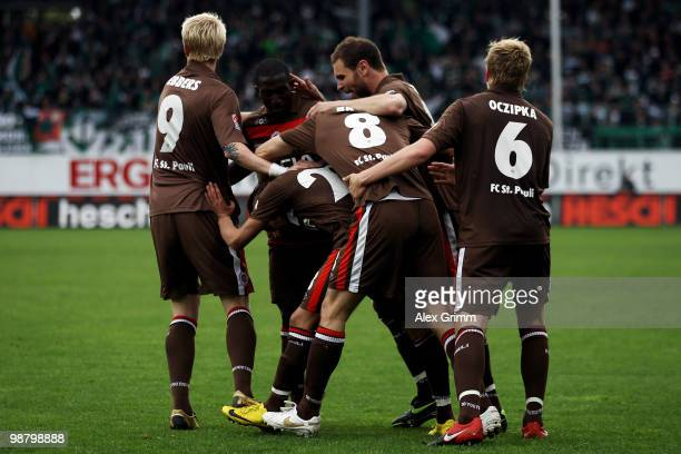 Deniz Naki of St Pauli celebrates his team's first goal with team mates during the Second Bundesliga match between SpVgg Greuther Fuerth and FC St...