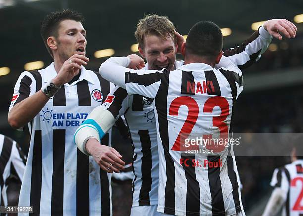 Deniz Naki of St Pauli celebrates with his team mates after scoring his team's second goal during the Second Bundesliga match between FC St Pauli and...