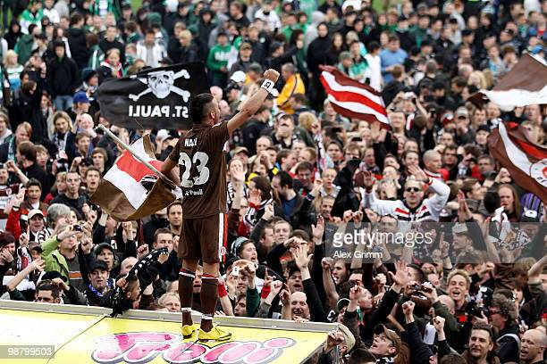 Deniz Naki of St Pauli celebrates with supporters after winning the Second Bundesliga match between SpVgg Greuther Fuerth and FC St Pauli at the...