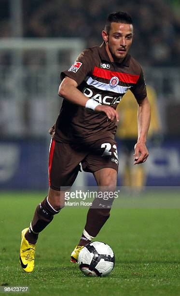 Deniz Naki of St Pauli runs with the ball during the Second Bundesliga match between FC St Pauli and FC Augsburg at the Millerntor Stadium on April...