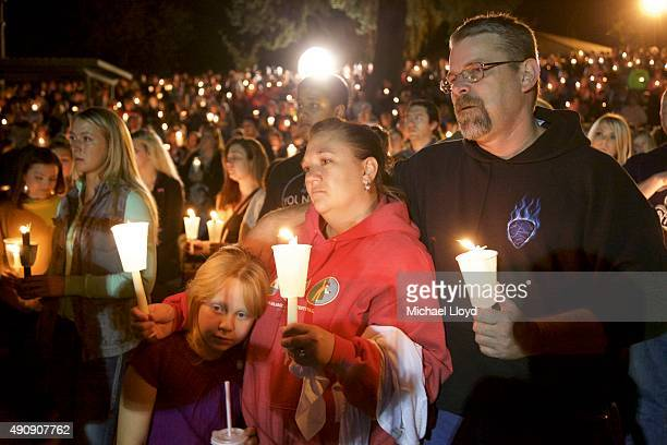 Denizens of Roseburg gather at a candlelight vigil for the victims of a shooting October 1 2015 in Roseburg Oregon According to reports 10 were...