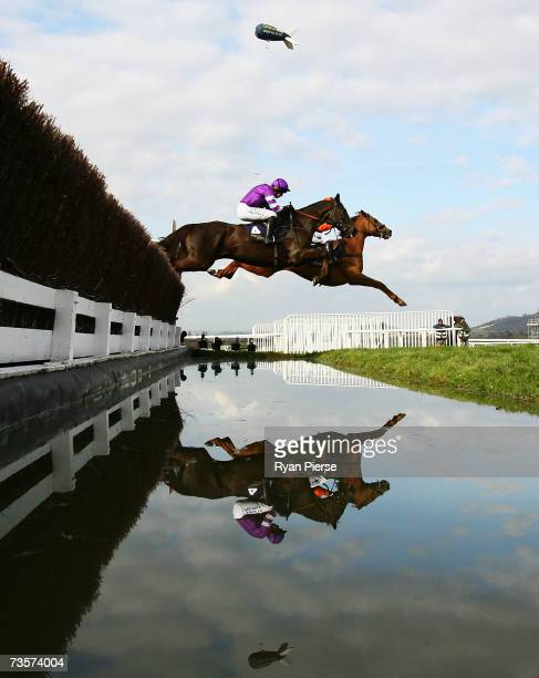Denman ridden by R Walsh clears the water jump during the Royal Steeple Chase on the second day of The Annual National Hunt Festival held at...