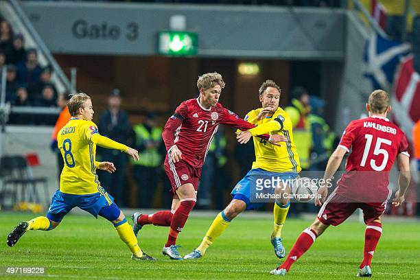 Denmark 21 Viktor Fischer takes on Sweden 8 Oscar Lewicki and Sweden 4 Andreas Granqvist durring a European Qualifier PlayOff between Sweden and...