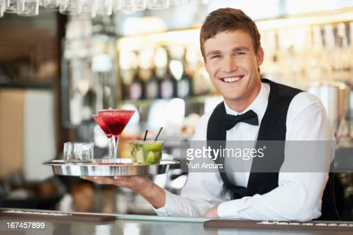 Denmark, Aarhus, Bartender holding tray with cocktails : Stock Photo