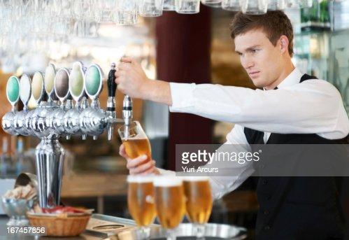 Denmark, Aarhus, Bartender pouring beer : Stock Photo