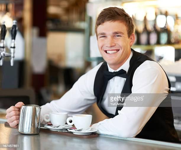 Denmark, Aarhus, Portrait of barista holding milk jug