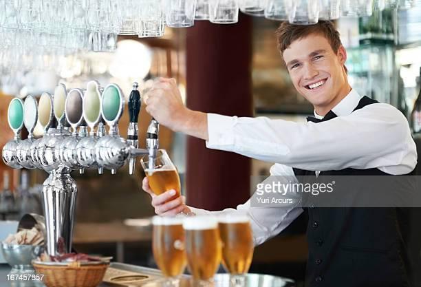 Denmark, Aarhus, Portrait of bartender pouring beer
