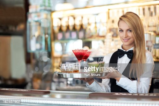 Denmark, Aarhus, Portrait of female bartender holding tray with cocktails : Stock Photo