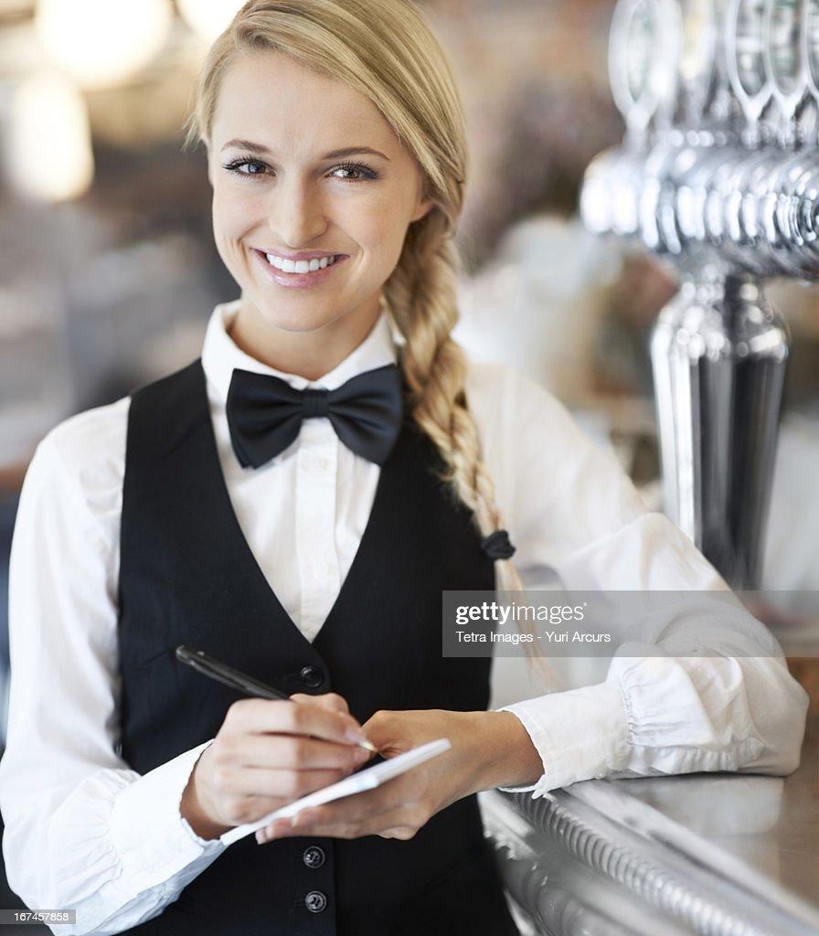 Denmark, Aarhus, Portrait of smiling waitress : Stock Photo