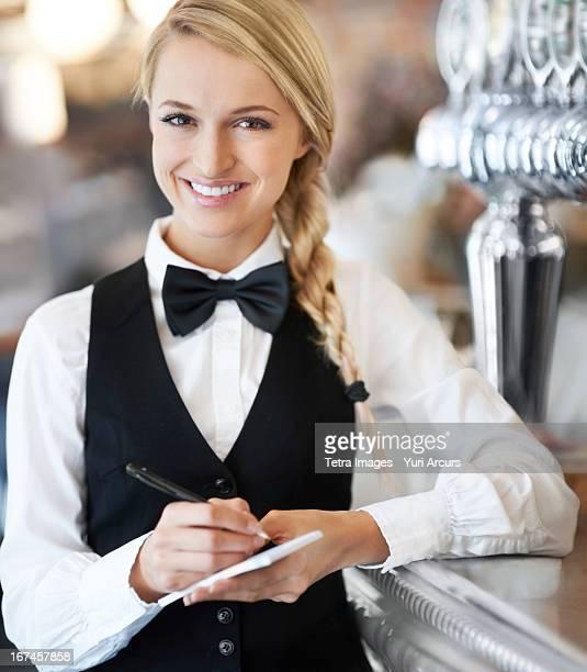 Denmark, Aarhus, Portrait of smiling waitress