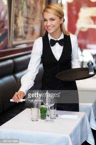 Denmark, Aarhus, Portrait of young waitress setting table : Stock Photo
