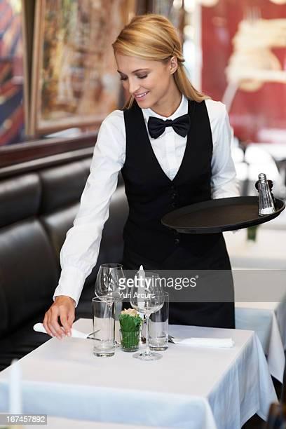 Denmark, Aarhus, Portrait of young waitress setting table