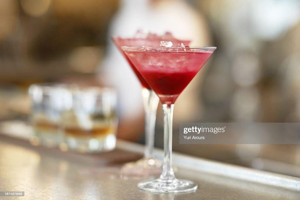 Denmark, Aarhus, Two martini glasses standing on bar counter : Stock Photo
