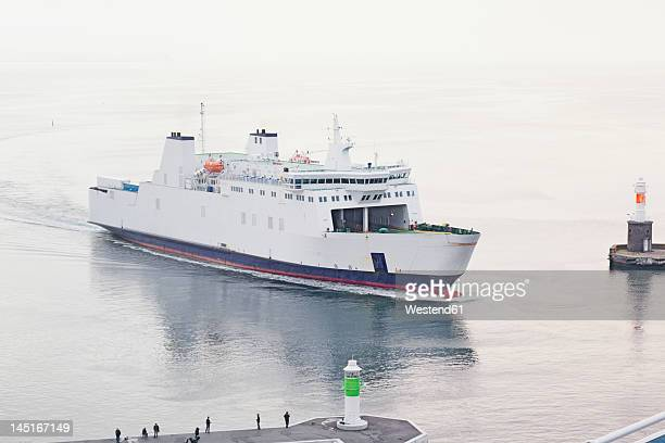 Denmark, Aarhus, View of entering ferryboat at harbour entrance with lighthouse