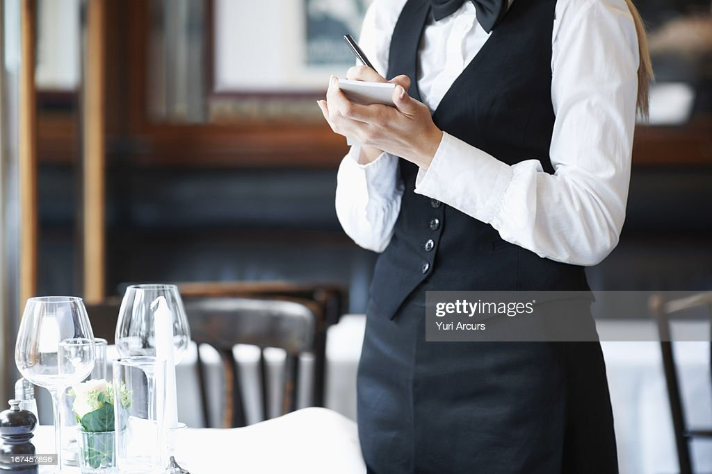 Denmark, Aarhus, Young waitress taking order : Stock Photo