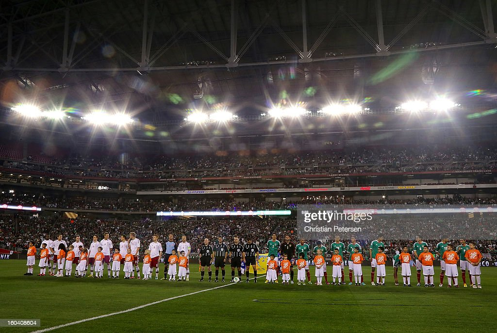 Denmark and Mexico line up for the National Anthems before an international friendly match at University of Phoenix Stadium on January 30, 2013 in Glendale, Arizona. Mexico and Denmark ended in a 1-1 draw.
