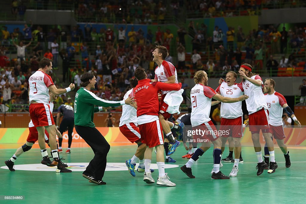 Denmark celebrates defeating France 2826 to win the gold medal in Men's Handball on Day 16 of the Rio 2016 Olympic Games at Future Arena on August 21...