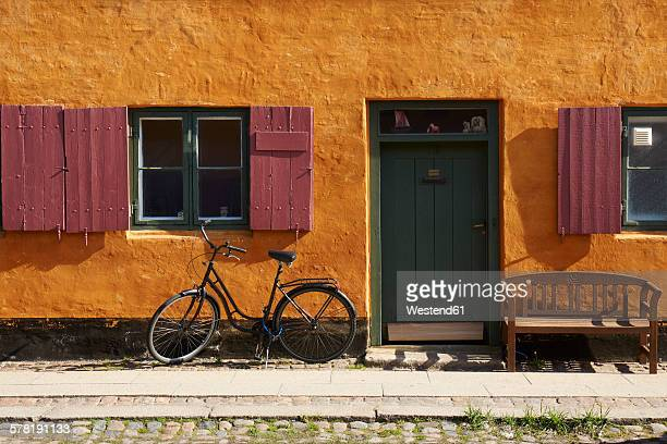 Denmark, Copenhagen, bicycle at yellow house