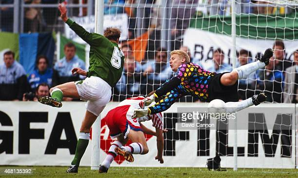 Denmark goalkeeper Peter Schmeichel makes a flying save from Republic of Ireland player Alan Kernaghan during a FIFA 1994 World Cup Qualifier at...