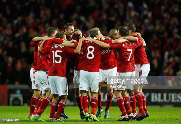 Denmark players celebrate at the end of the match after winning 21 against Portugal during the EURO 2012 group H qualifier match between Denmark and...