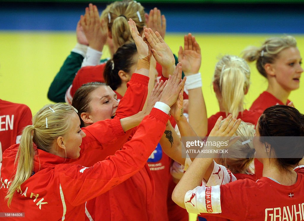 Denmark players celebrate their victory over Czech Republic after the 2012 EHF European Women's Handball Championship Group II match between Czech Republic and Denmark on December 10 , 2012, at the Kombank Arena in Belgrade. Denmark won 33-30.