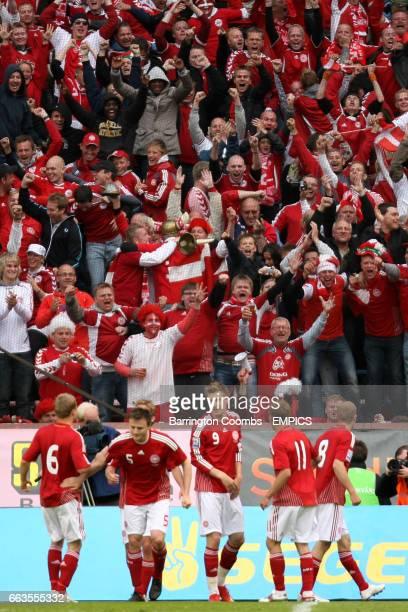 Denmark players celebrate Thomas Kahlenberg's winning goal